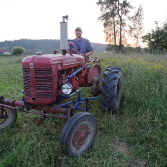 A Farmer and his tractor
